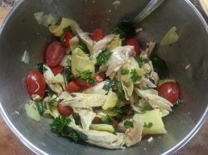 A fresh take on chicken salad: chicken, tomatoes, parsley, artichoke hearts dressed with white wine vinegar and olive oil.